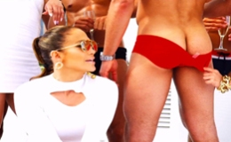 J.Lo spices up new video with man candy